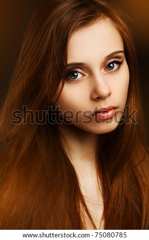 portrait of beautiful fashionable woman on dark background
