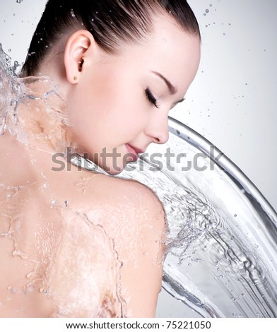 Portrait of beautiful female face with clean water - studio - stock photo