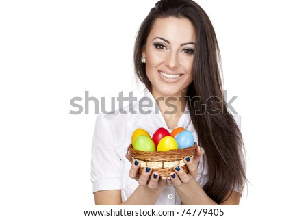 Portrait of beautiful female holding basket with Easter eggs isolated on white background - stock photo