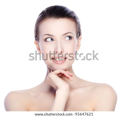 Portrait of beautiful female model looking up on white background - stock photo
