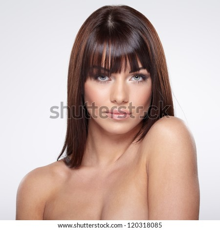 Portrait of beautiful female model on grey background