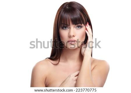 Portrait of beautiful female model on white background - stock photo