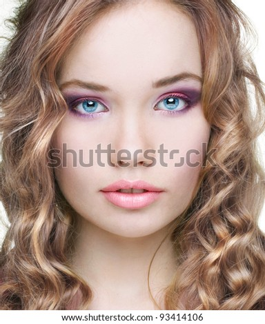 Portrait of beautiful female model with make up on white background - stock photo