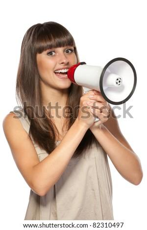 Portrait of beautiful female proclaiming into the loudspeaker, isolated on white background - stock photo