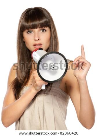 Portrait of beautiful female proclaiming through the loudspeaker, isolated on white background - stock photo