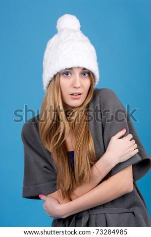 Portrait of beautiful freezing woman in winter hat - stock photo