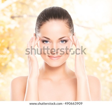 Portrait of beautiful, fresh and healthy girl over seasonal autumn background.