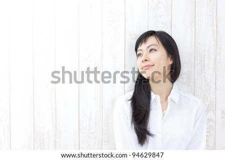 portrait of beautiful girl against a rustic wooden wall