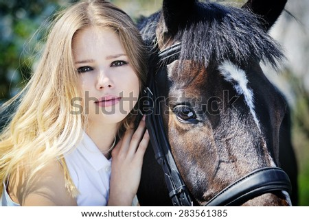 Portrait of beautiful girl and horse in spring