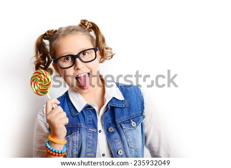 portrait of beautiful girl blonde, schoolgirl and teenager with lollipop on a white background - stock photo