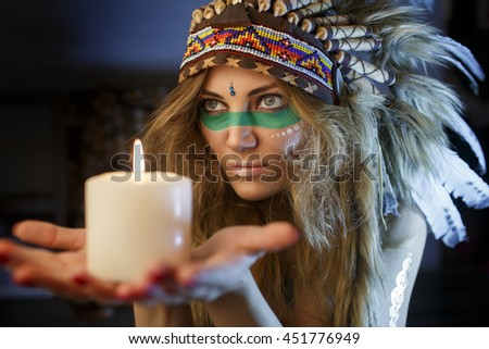 Portrait of beautiful girl close up in the attire of an Indian America with a candle in his hand