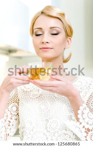 Portrait of beautiful girl drinking tea - stock photo