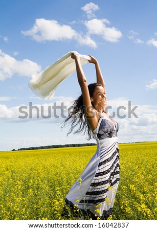 Portrait of beautiful girl having a fun in the field - stock photo