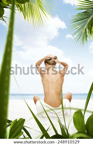 Portrait of beautiful girl having good time on the beach - stock photo