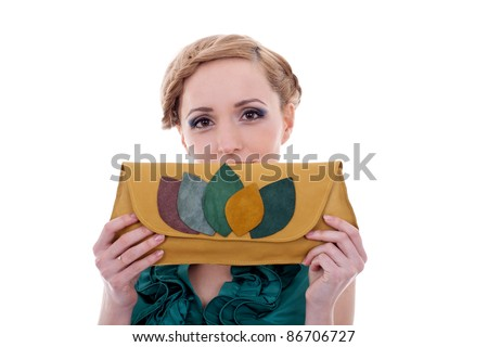portrait of beautiful  girl holding a purse over her face - stock photo