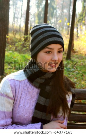 Portrait of beautiful girl in autumn park