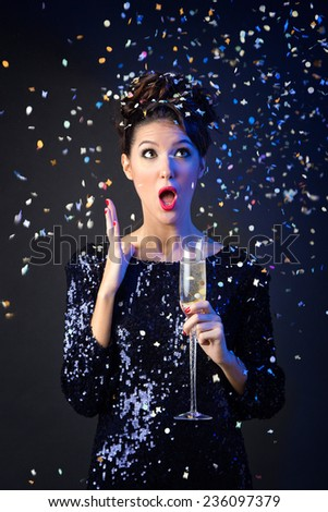 Portrait of beautiful girl in evening dress with wine glass. New Year's Eve. - stock photo