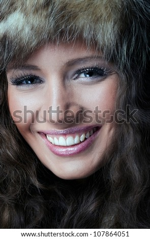 Portrait of beautiful girl in fur hat