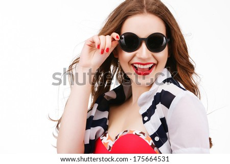 Portrait of beautiful girl in glasses laughs