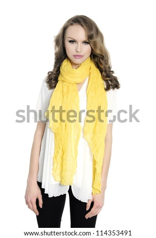 portrait of beautiful girl in jeans with yellow scarf posing