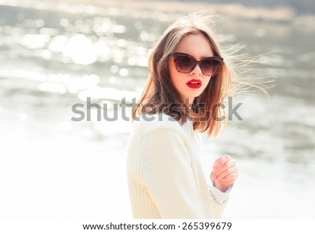 portrait of beautiful girl in sunglasses - stock photo