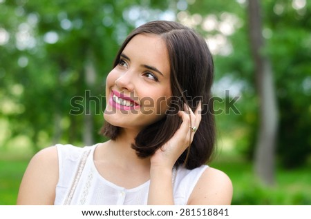 Portrait of beautiful girl in the nature on colorful spring day.  - stock photo