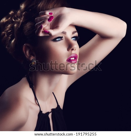 Portrait of beautiful girl in the studio with clean skin and bright makeup - stock photo