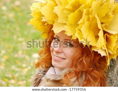 Portrait of beautiful girl in wreath of leaves