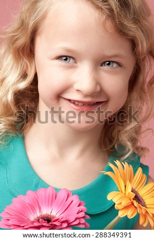 Portrait of beautiful girl laughing with flowers - stock photo