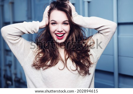 Portrait of beautiful girl laughs widely - stock photo