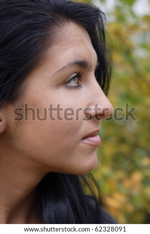 Portrait of Beautiful girl outdoors. More images of this models you can find in my portfolio - stock photo