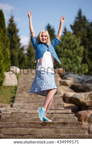 Portrait of beautiful girl posing in the Park fashion style skirt jacket - stock photo