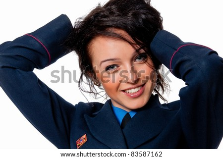 portrait of beautiful girl posing in uniform smiling isolated on white background - stock photo
