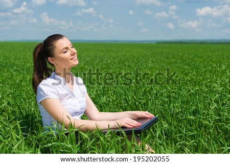 portrait of beautiful girl relaxing on field