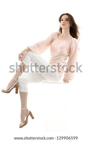 portrait of beautiful girl sitting cube - stock photo
