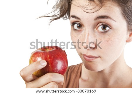Portrait of beautiful girl with an apple