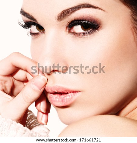 Portrait of beautiful girl with an evening make-up, close-up