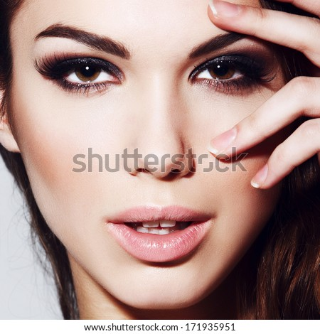 Portrait of beautiful girl with an evening make-up, close-up - stock photo