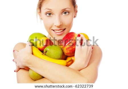 portrait of beautiful girl with assorted fruits on white - stock photo