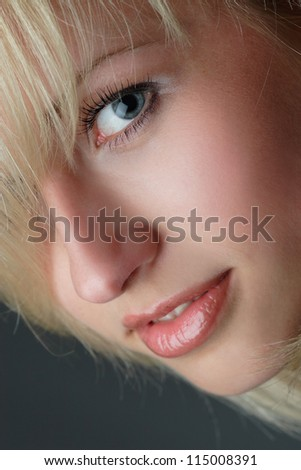 portrait of beautiful girl with blond hair luxuriant