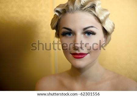 Portrait of beautiful girl with blue eyes and red lips - stock photo