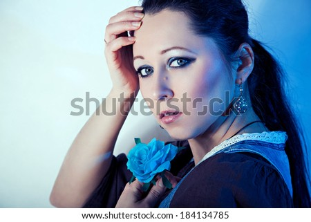 Portrait of  beautiful girl with blue rose - stock photo