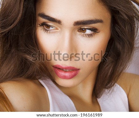 Portrait of beautiful girl with bright make-up, close-up. Studio shot - stock photo