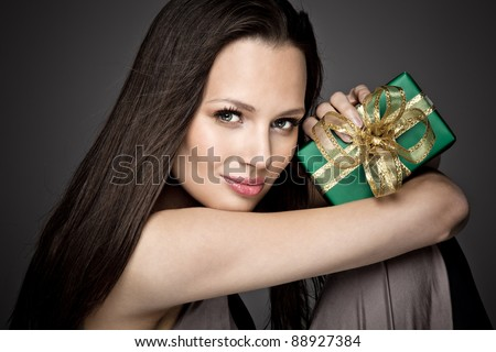 Portrait of beautiful girl with christmas gift - stock photo