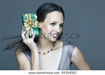 Portrait of beautiful girl with christmas gift - stock photo