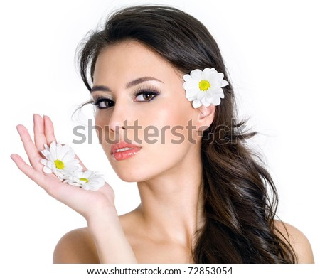 Portrait of beautiful girl with clean face with flower - white background