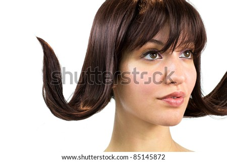 Portrait of beautiful girl with crazy hair-do. - stock photo