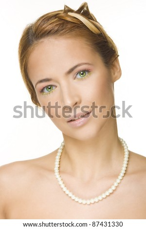 Portrait of beautiful girl with creative braid hairdo and pearls - stock photo