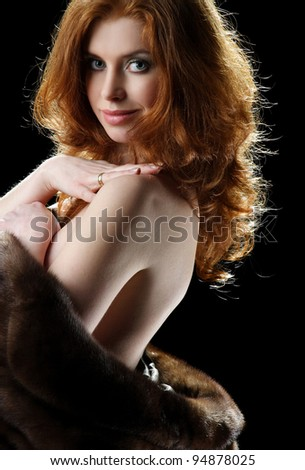 portrait of beautiful girl with curly hair luxuriant