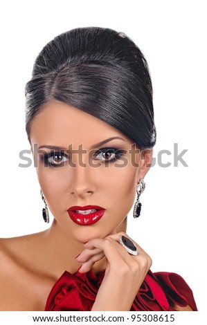 portrait of beautiful girl with elegant coiffure and red dress on white - stock photo